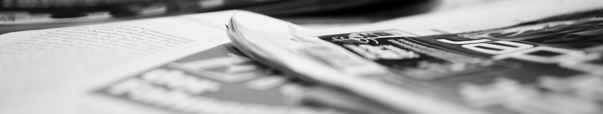 Black and white photo of newspapers