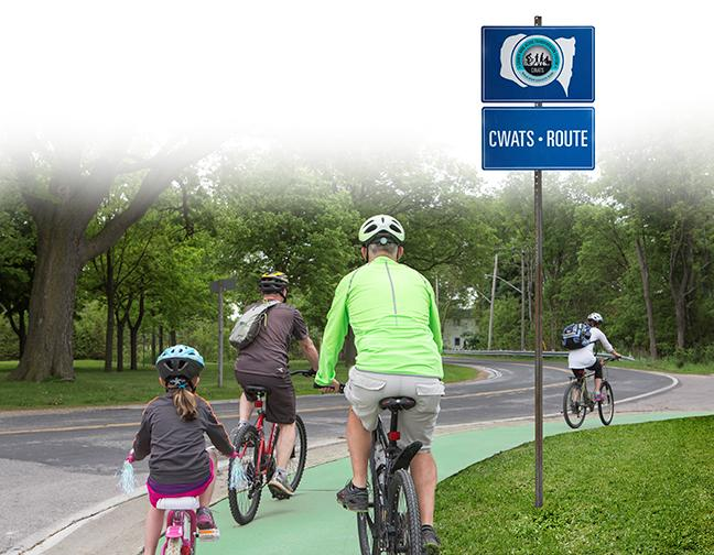 A group of people cycling on the CWATS network.