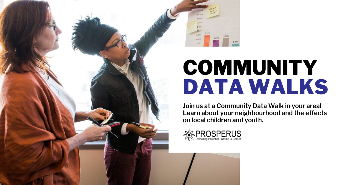 Two women looking at graphs on a bulletin board.