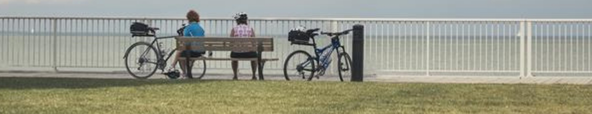Cyclists resting on bench