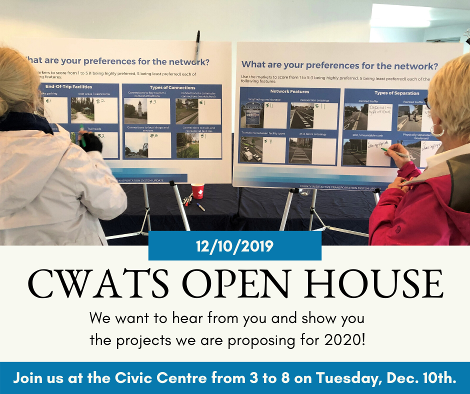 Two woman seen from behind looking at CWATS boards at an Open House, with details of the upcoming Open House at the Essex County Civic Centre from 3 to 8 on Dec. 10th