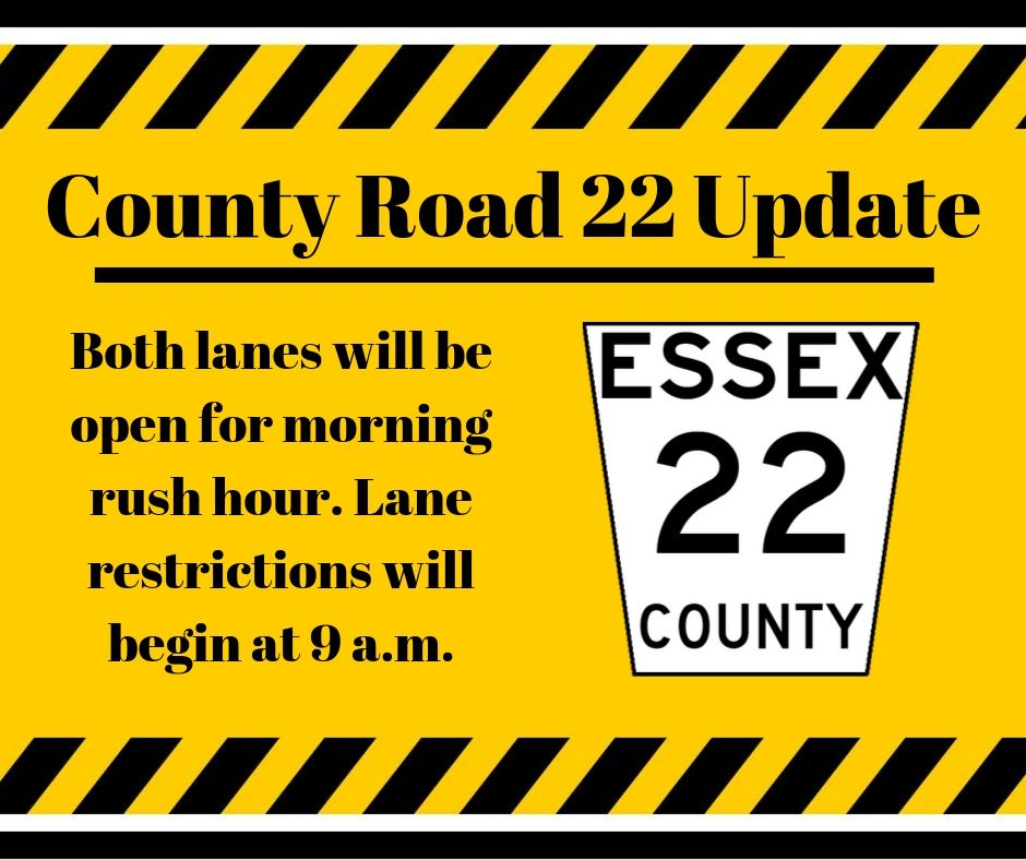 Black letter against a yellow background advising that lane restrictions take effect on County Road 22 at 9 a.m.