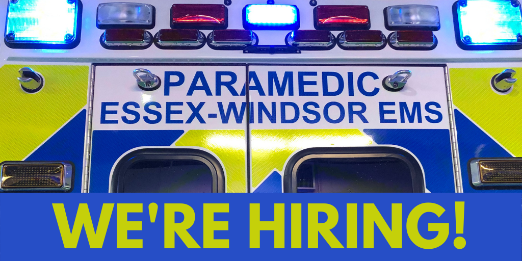 The words 'We're Hiring' against the backdrop of an ambulance