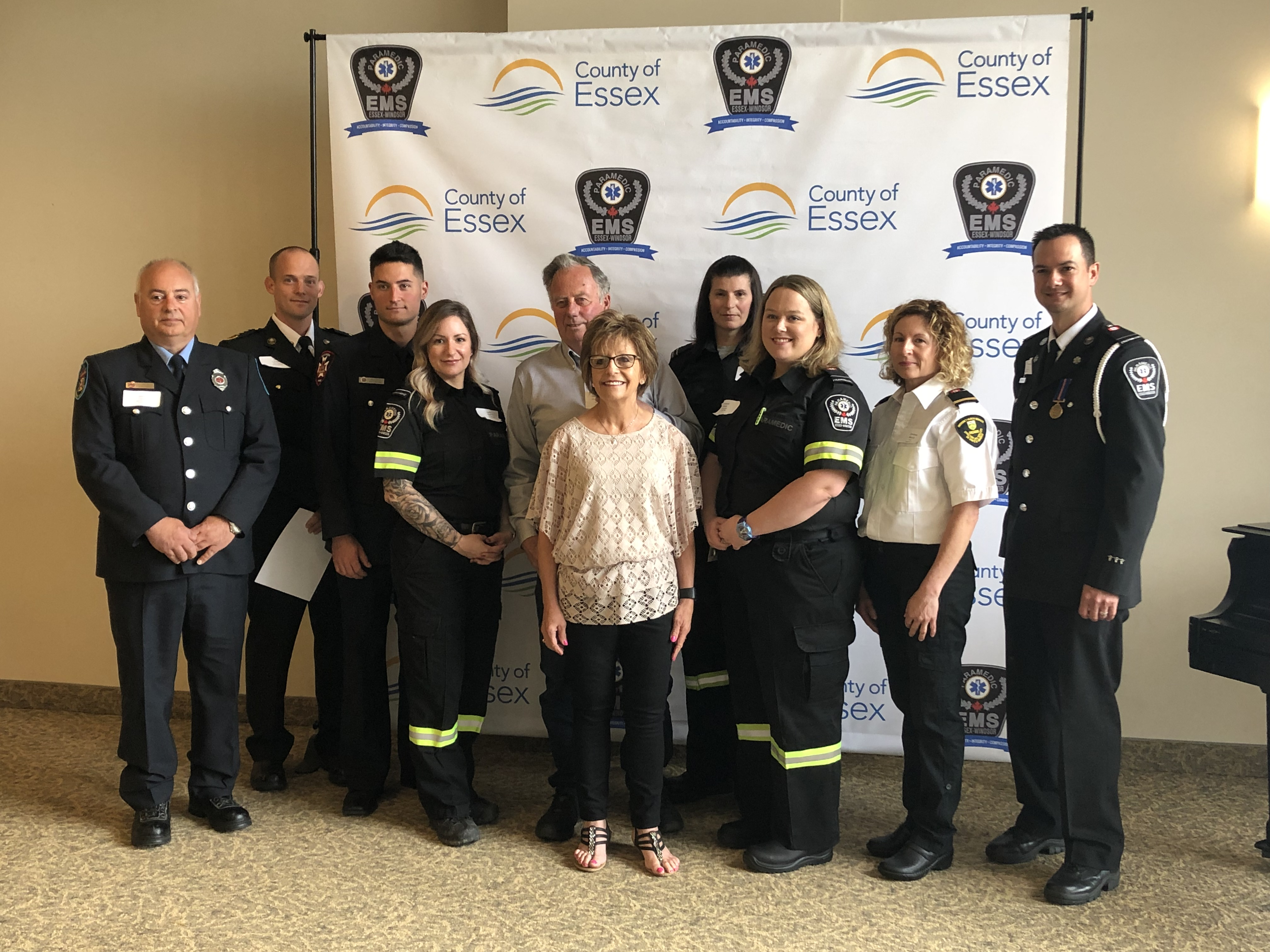 Brian Wylie is surrounded the paramedics who saved his life.