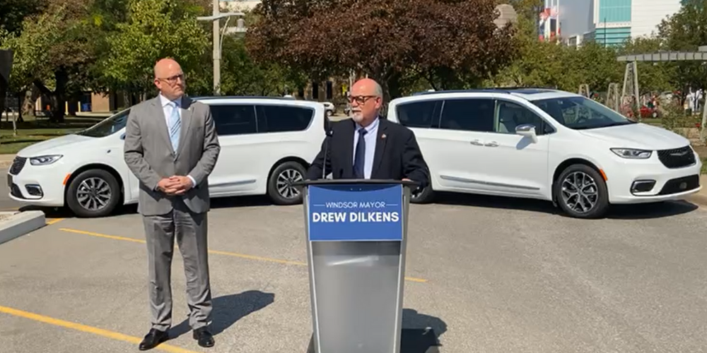 Windsor Mayor Drew Dilkens and Essex County Warden Gary McNamara with two Chrysler Pacificas