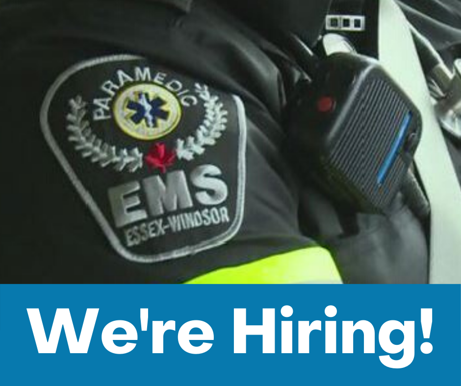 A close up of the EMS logo on a uniform and the words: 'We're Hiring!'