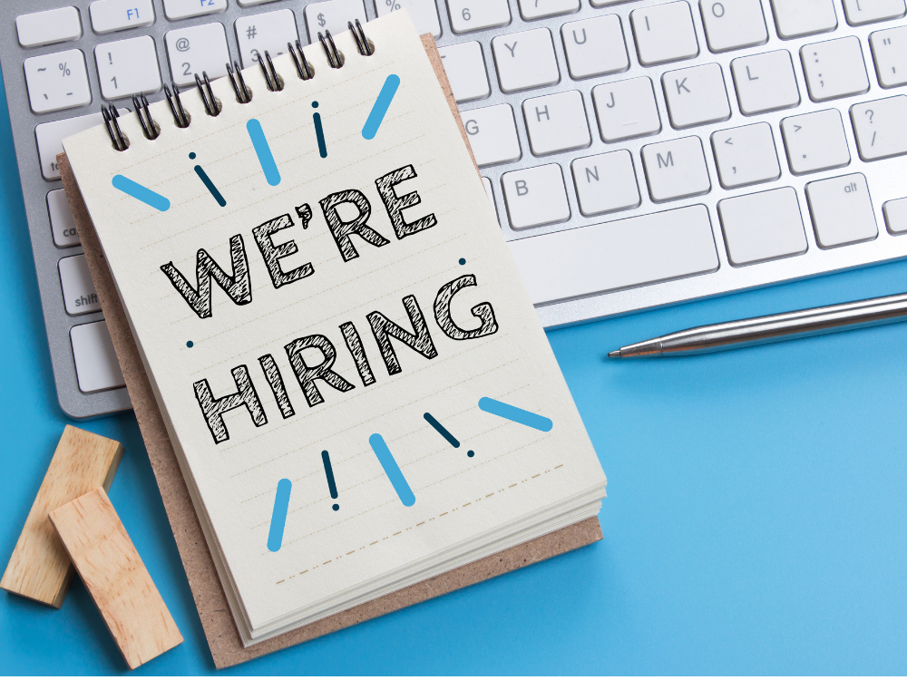We're hiring on a notebook and a computer keyboard