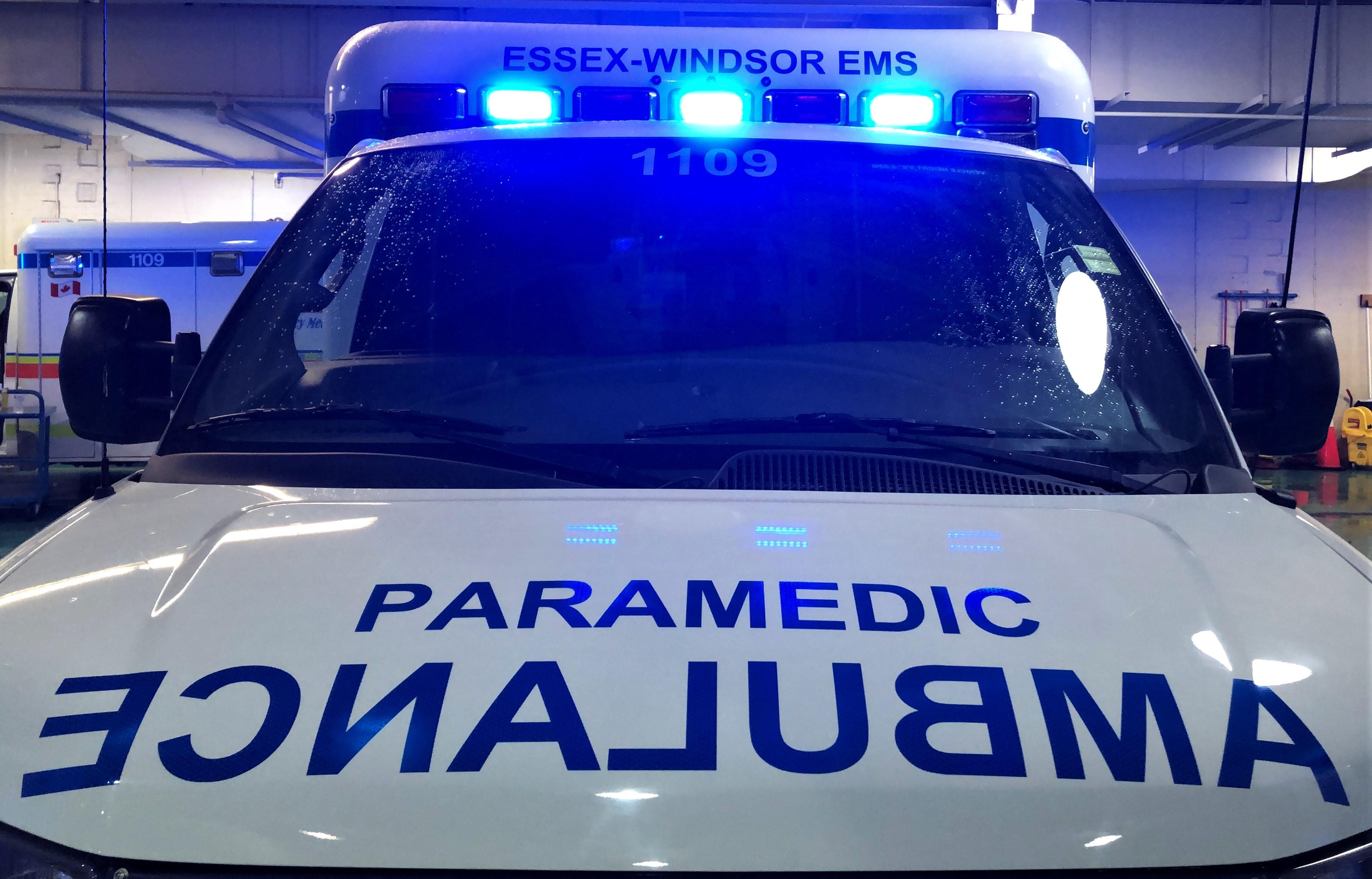 Blue lights flash on the front of an Essex-Windsor EMS ambulance.