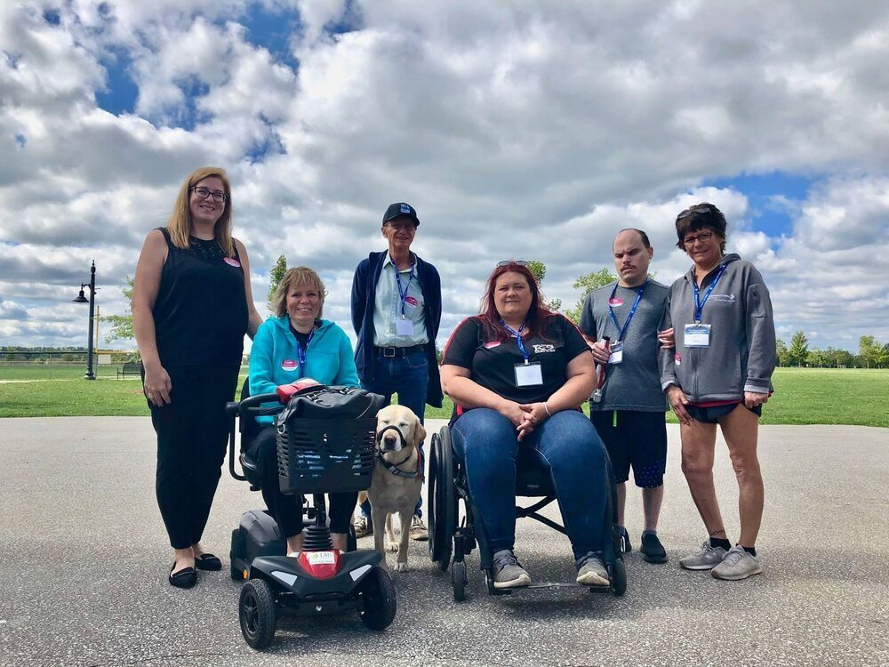 Essex NDP MP Tracey Ramsay and Kingsville Deputy Mayor Gord Queen with members of the Essex County Accessibility Advisory Committee.