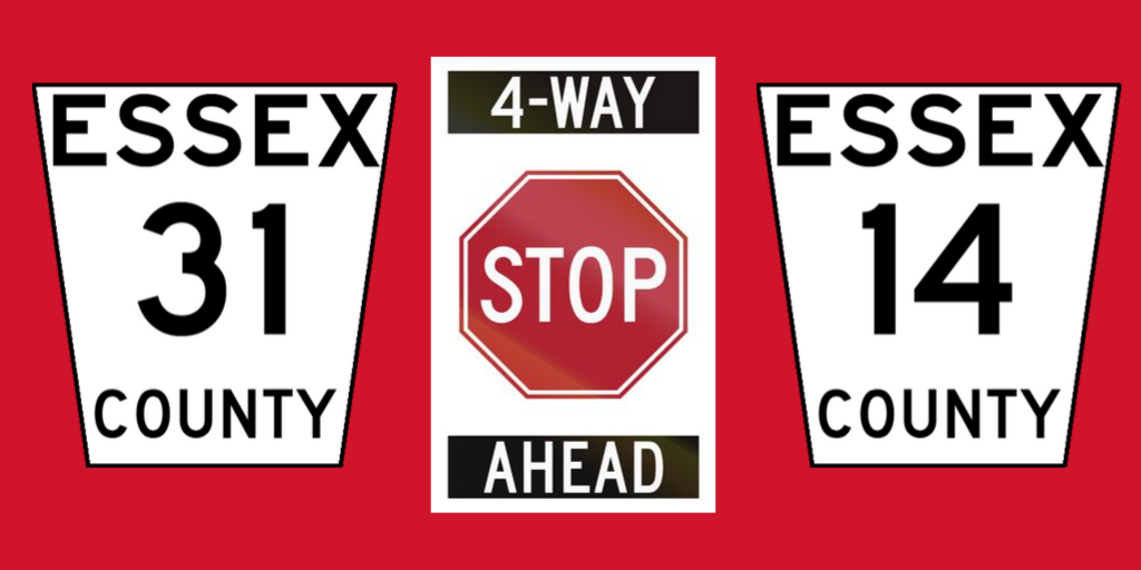 Road shields for County Roads 31 and 14 flanking a Stop Sign against a red background