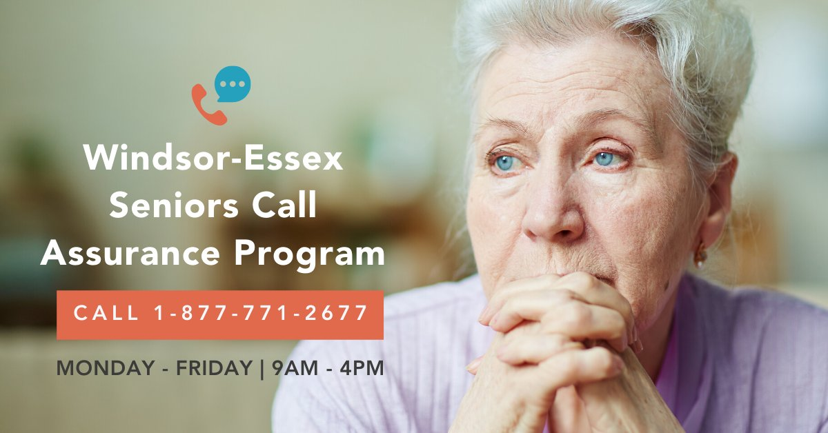 A woman with information about the new Seniors' help hotline at 877-771-2677.