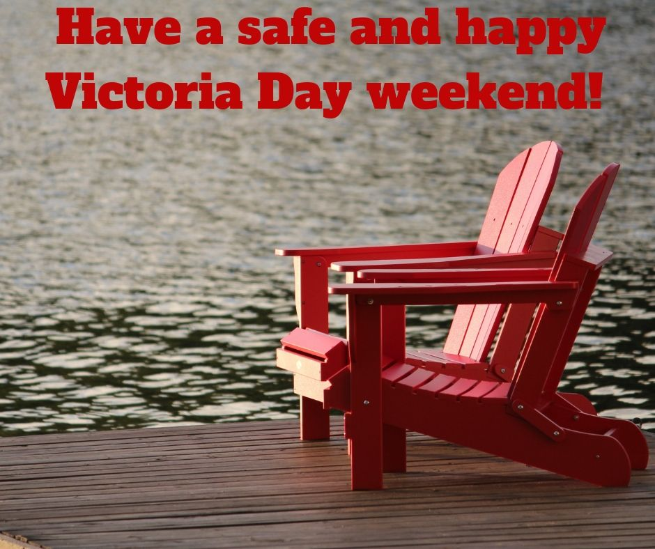 Two red lawn chairs on a dock and the words: 'Have a safe and happy Victoria Day weekend'