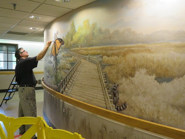 Artist Martin Lacasse paints a Point Pelee mural at Sun Parlor home