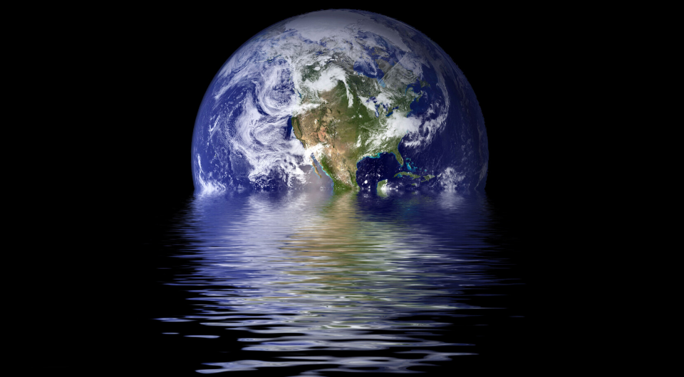 An aerial view of the Globe partially submerged in water.